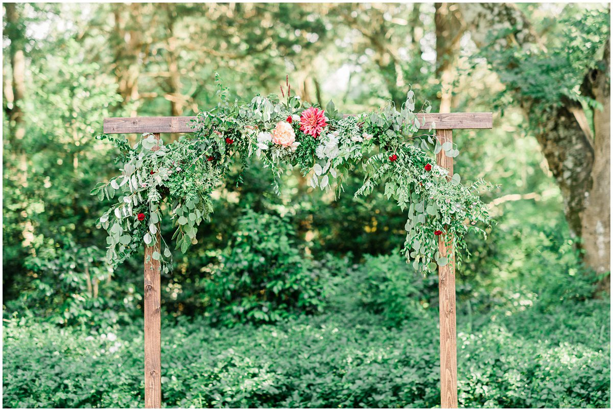 Wedding Ceremony Outdoor Arch with flowers and greenery