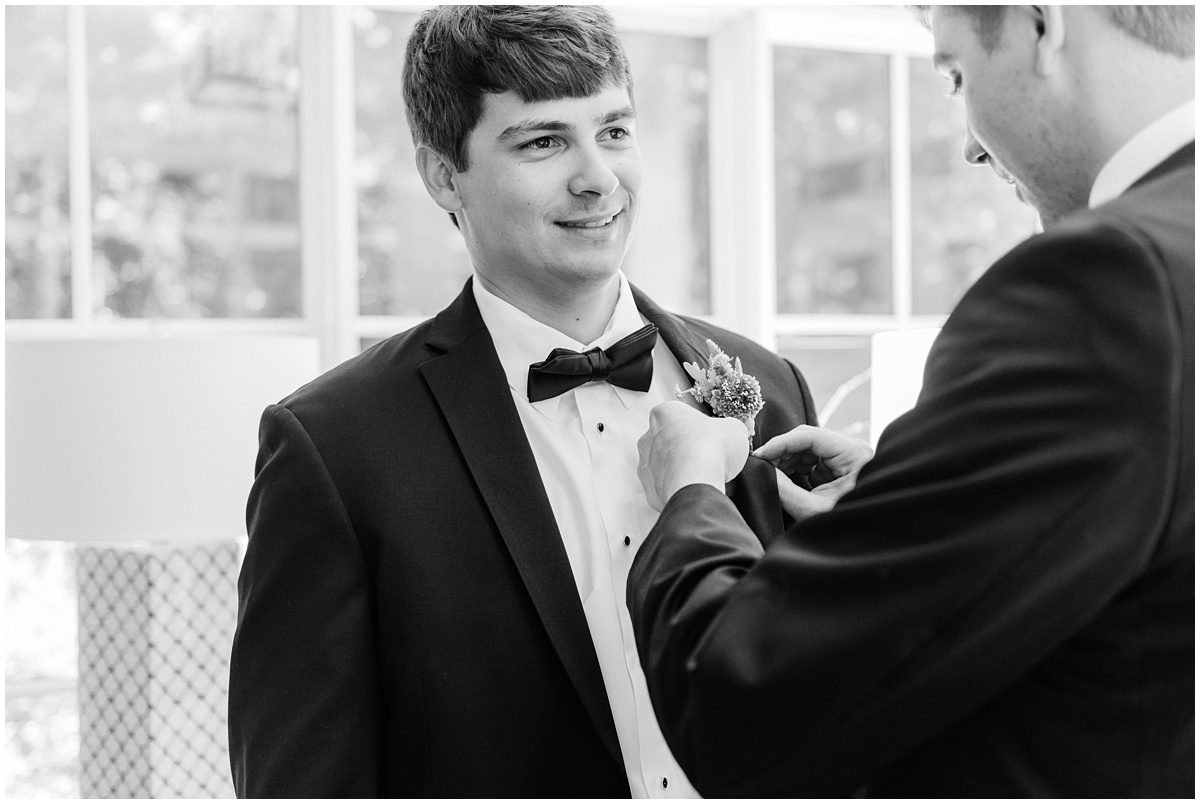 Black and white groom getting ready photos