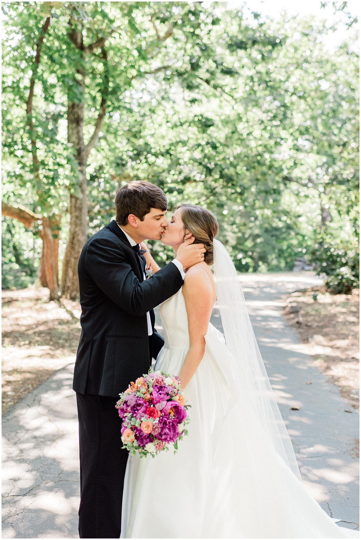 Bride and Groom portrait with bright pink bouquet