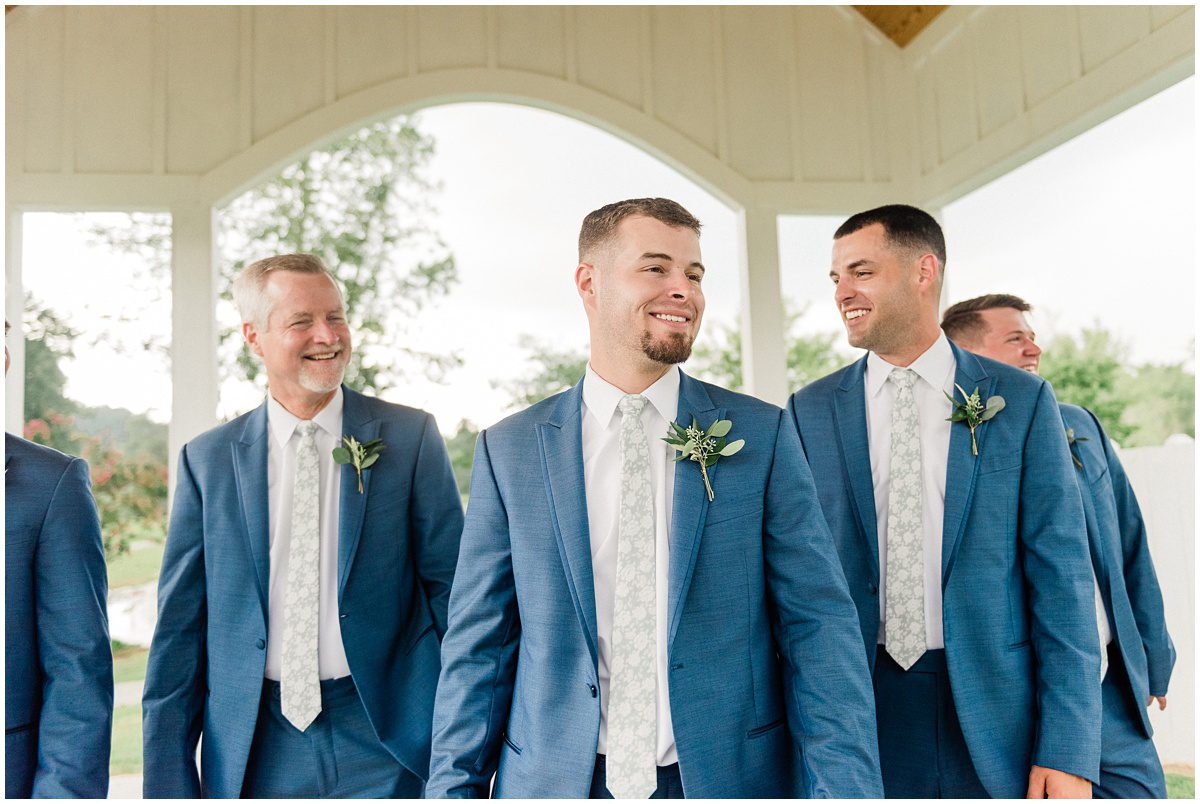 Groom and Groomsmen with floral tie details
