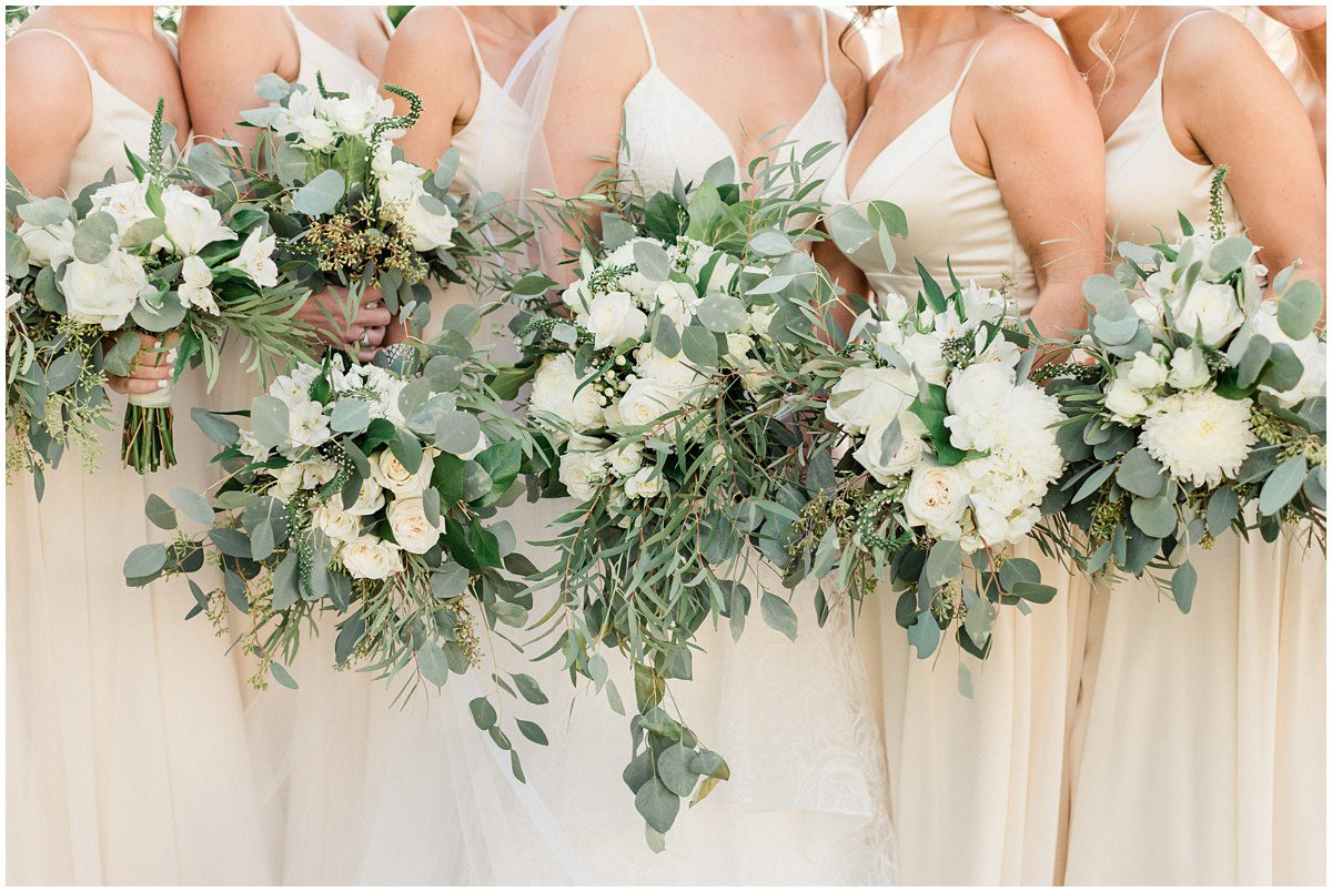 Champagne bridesmaid dresses with white floral bouquets