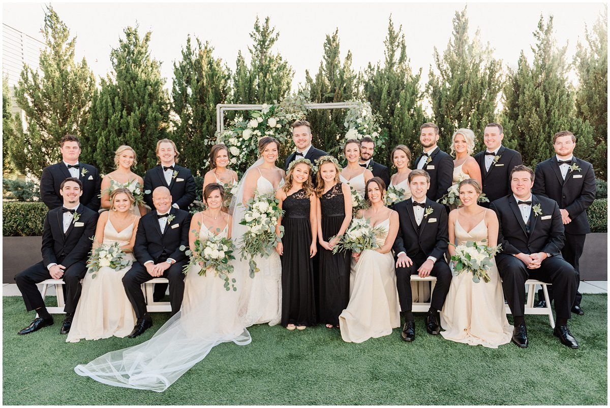 Champagne and black bridal party