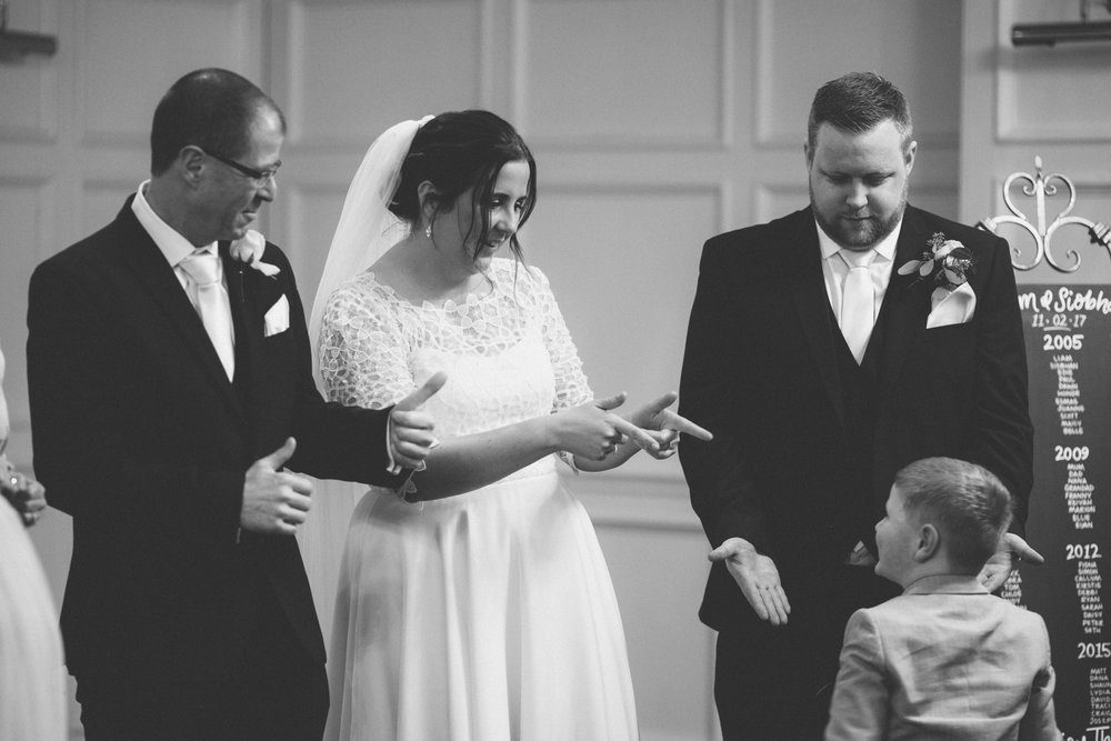 A young guest is greeted by the bride and groom in the receiving line at a Lincolnshire wedding.