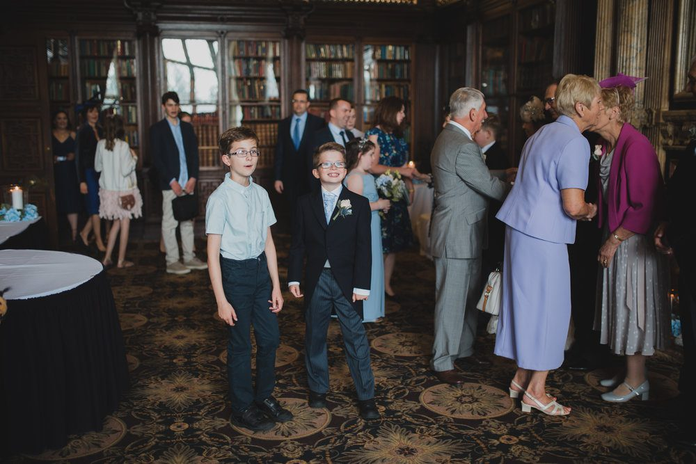 The receiving line in the library at a Crewe Hall wedding in Cheshire. By Amanda Balmain Photography.