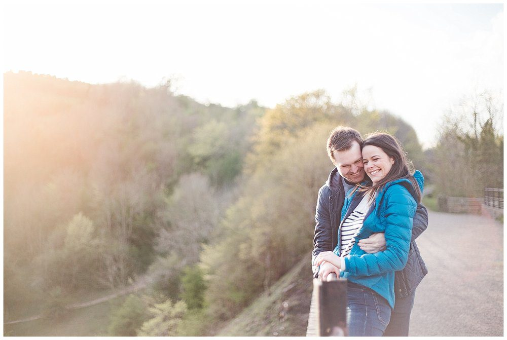 Couple embracing and laughing on the Monsal Trail in the Peak District