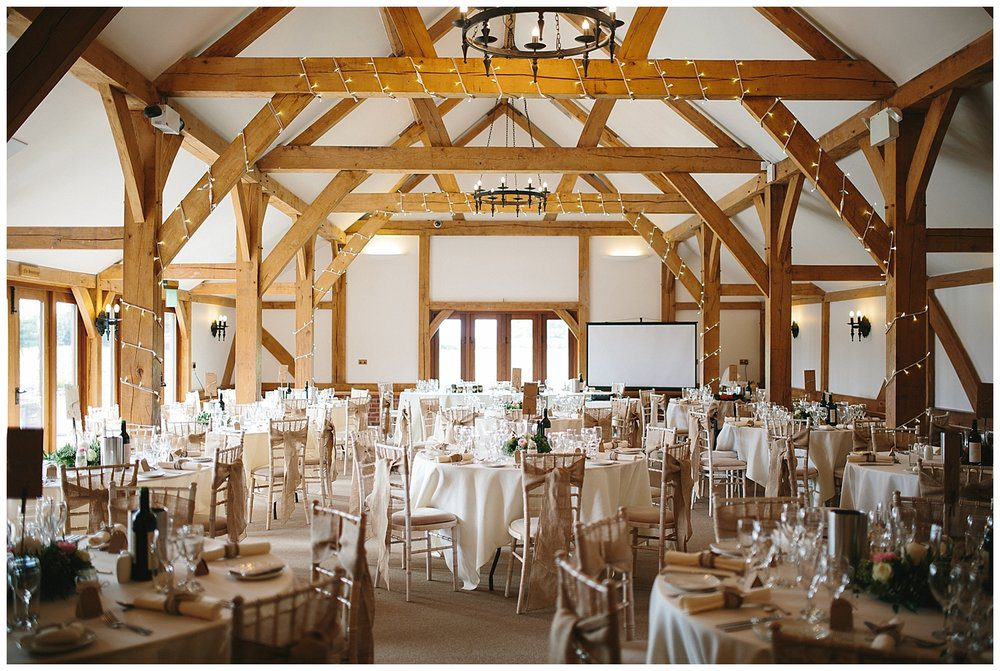 Cheshire barn wedding venue with beautiful grounds and lake.