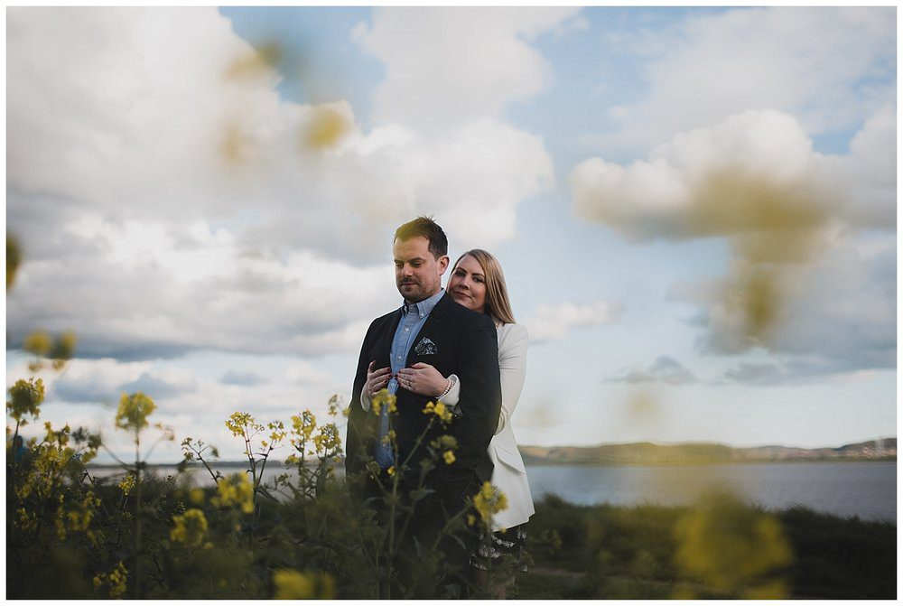 Engaged couple at Hale, Liverpool with yellow flowers.