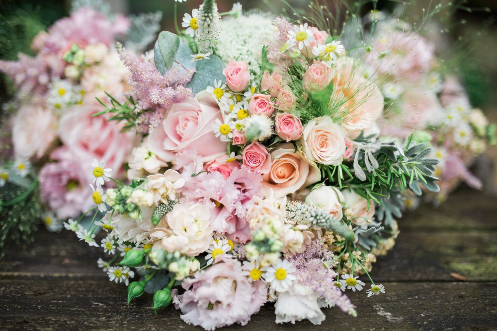 Pastel summer bouquet with herbs.