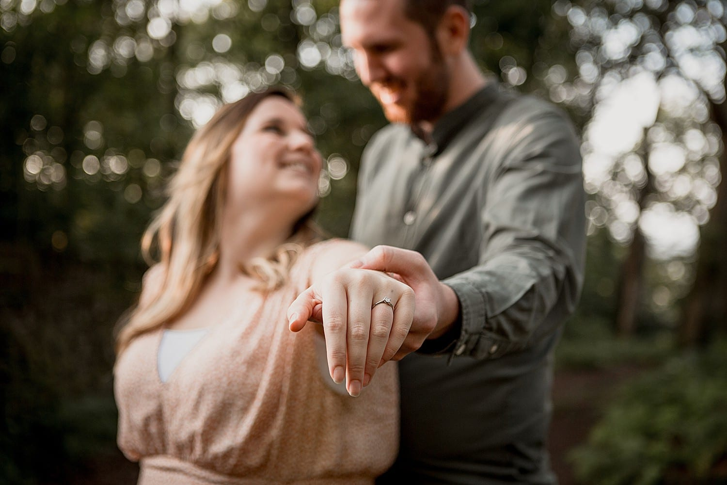 engaged couple show off the ring