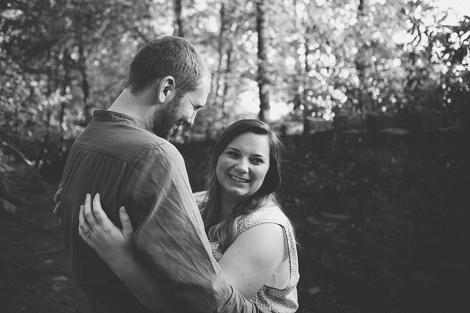 engaged couple laughing