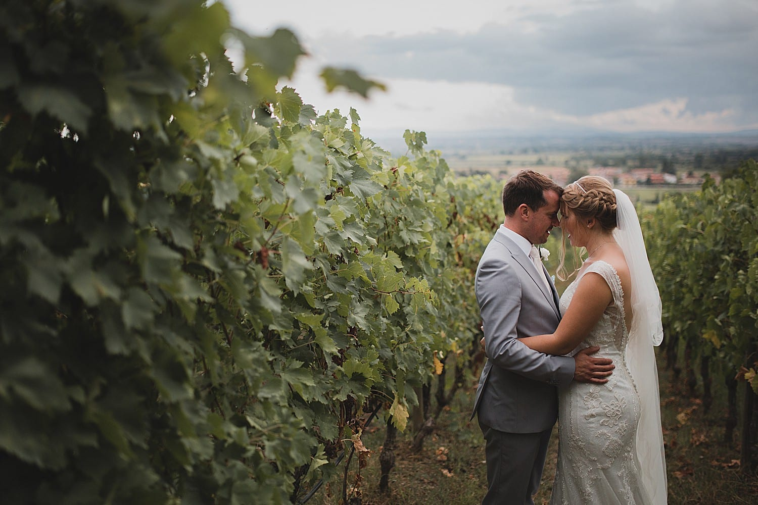 Bride and groom in Tuscany vineyard