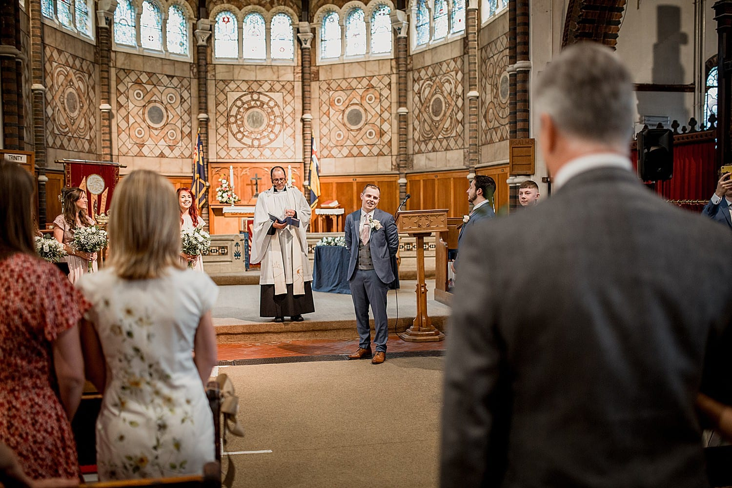 Groom sees his bride at church wedding