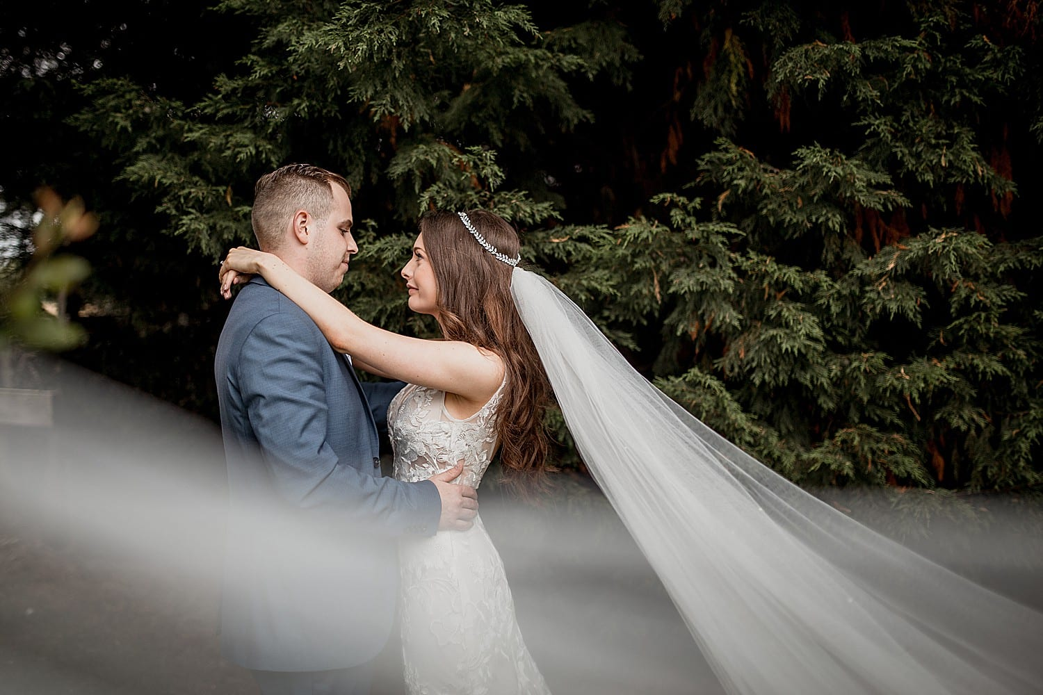 bride and groom portrait with long veil