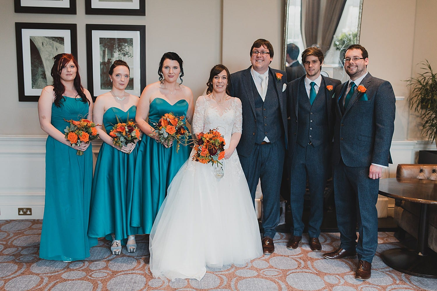 teal and russet wedding party