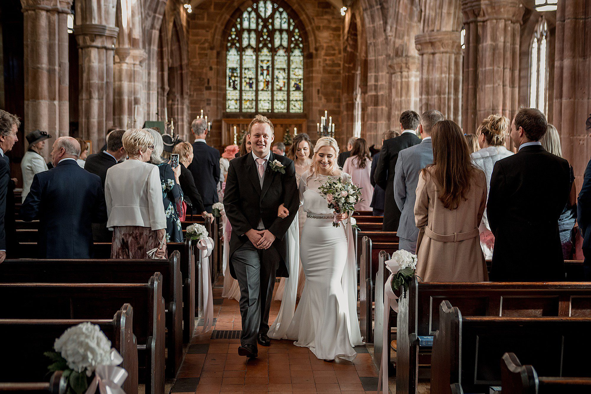 bride and groom at great budworth church