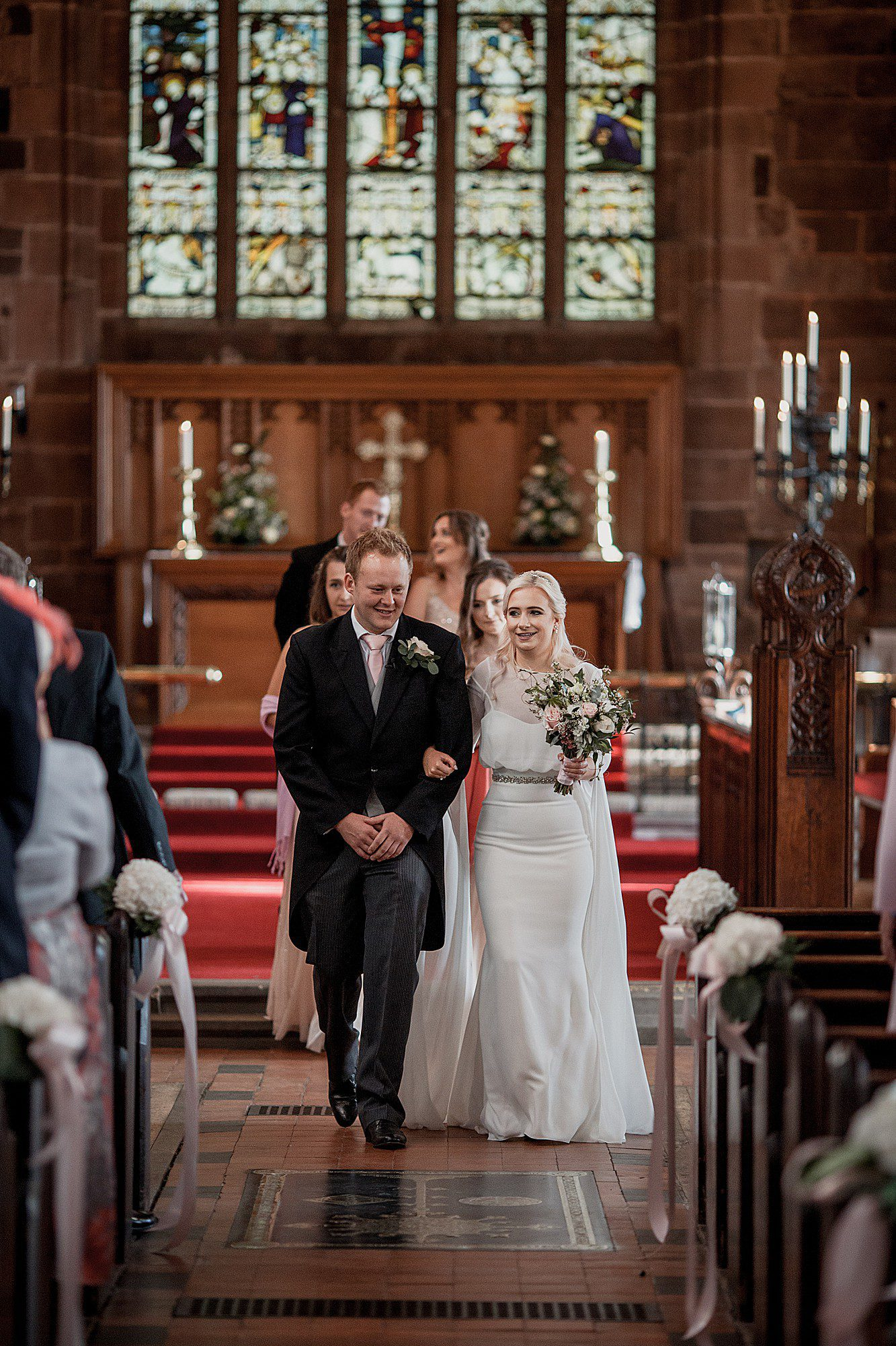 bride and groom at delamere manor church wedding