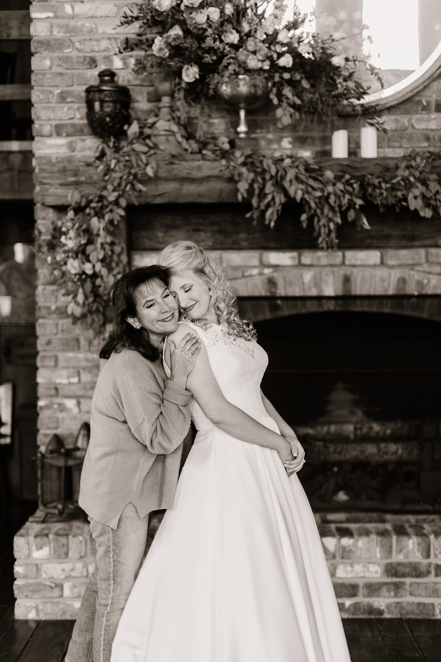 Mother and daughter hugging in sweet getting ready moment on a bride's wedding day in Hattiesburg MS