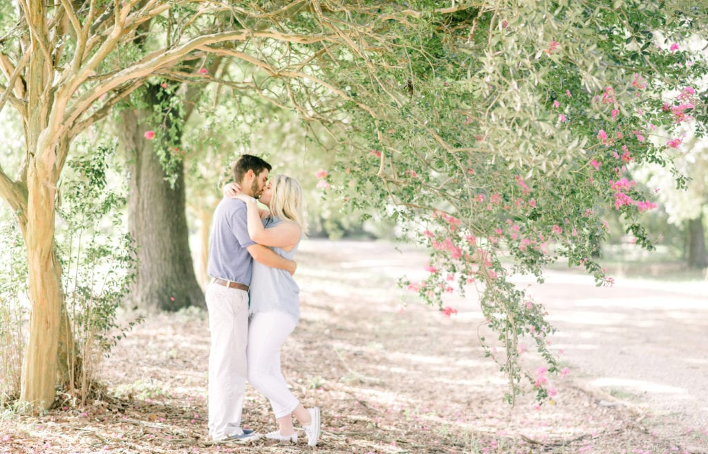 couple during engagement session at LSU Botanical Garden