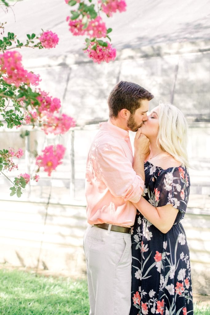 couple kissing at engagement session at LSU Botanical Gardens