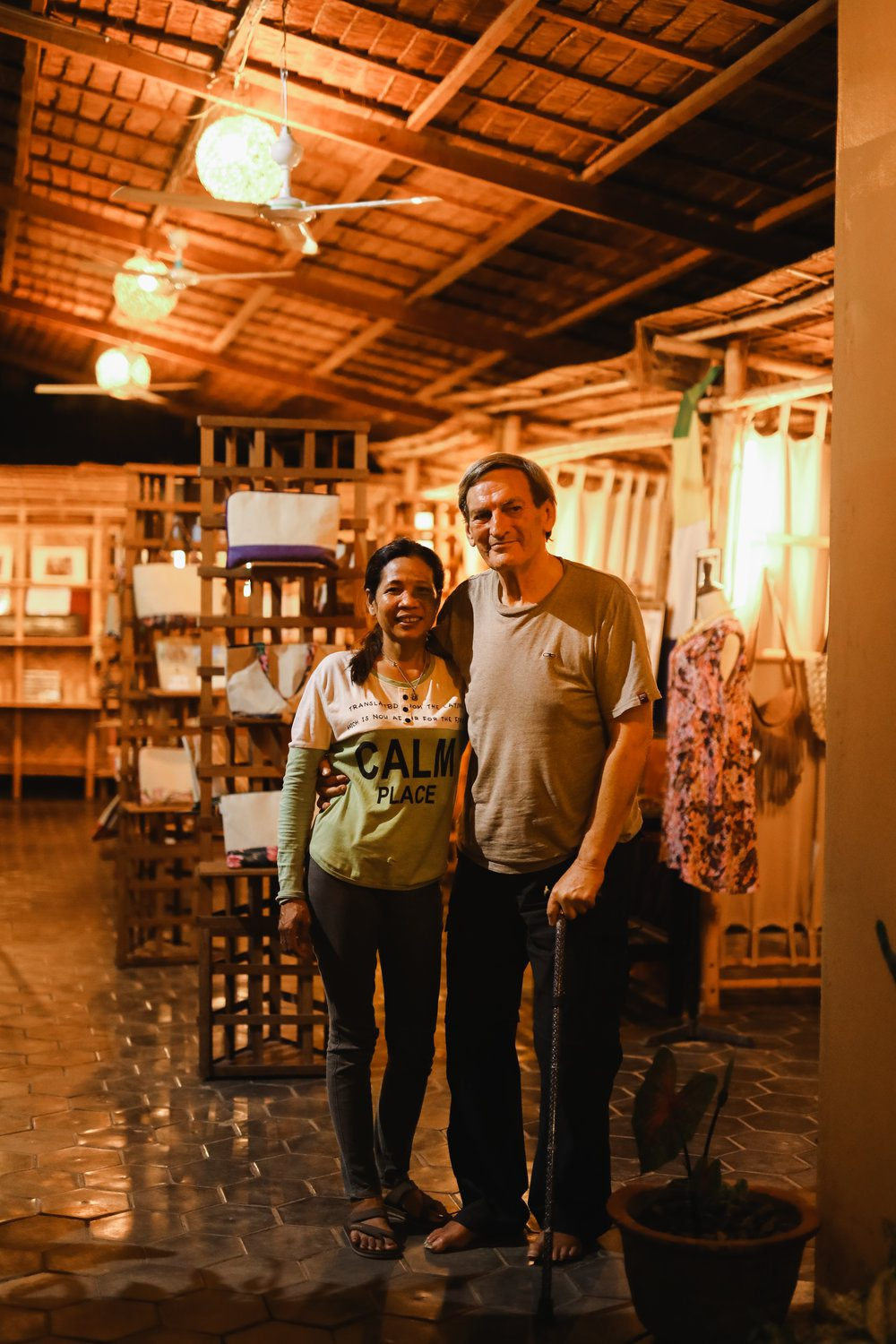 Naret & Rick in front of their local shop